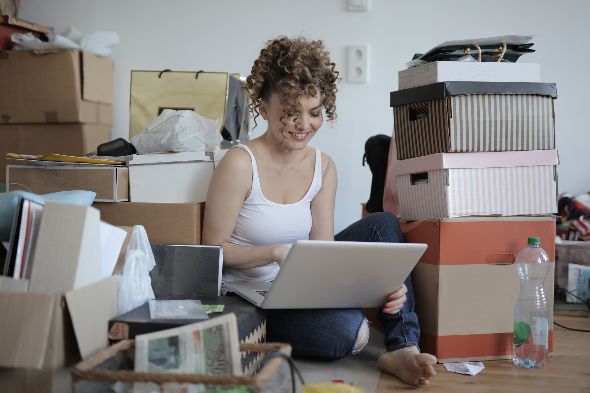 Woman online shopping on floor