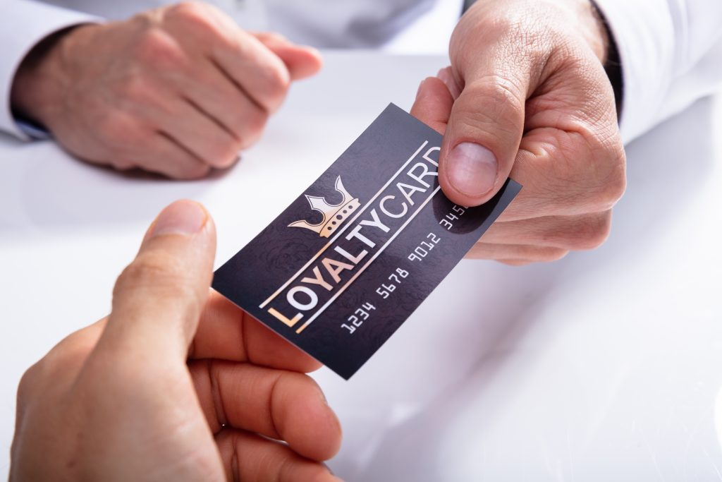 Man giving loyalty card