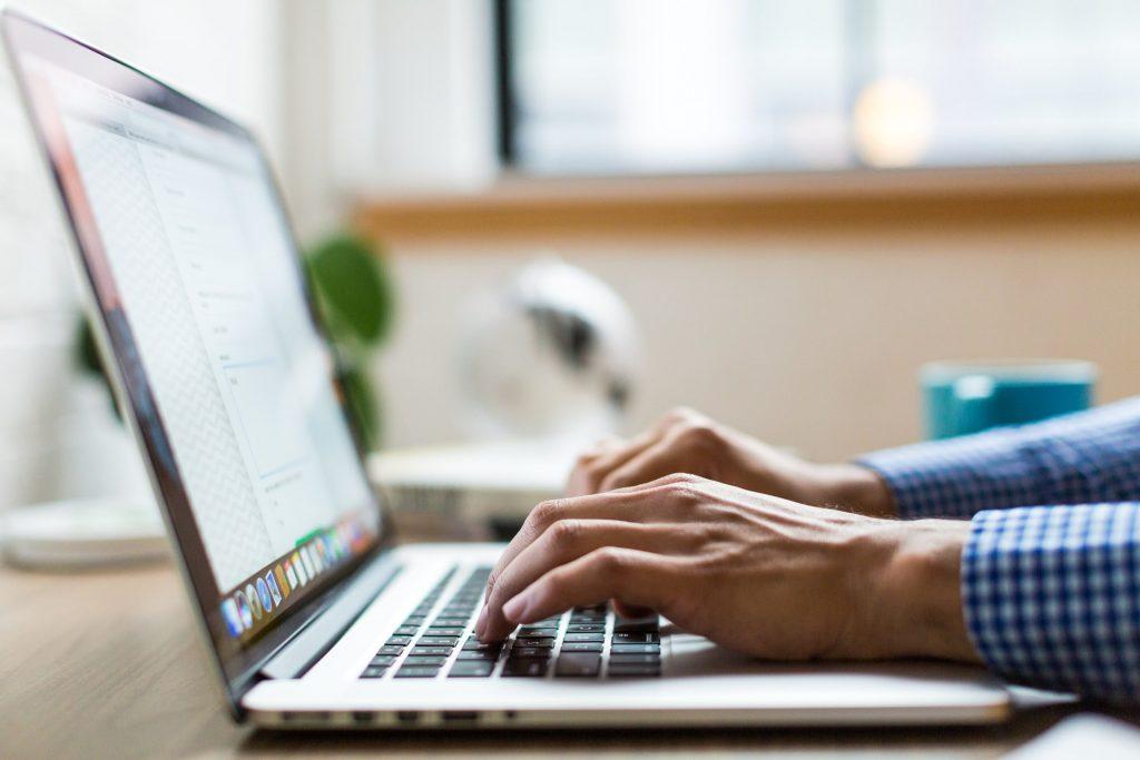 Man typing up close