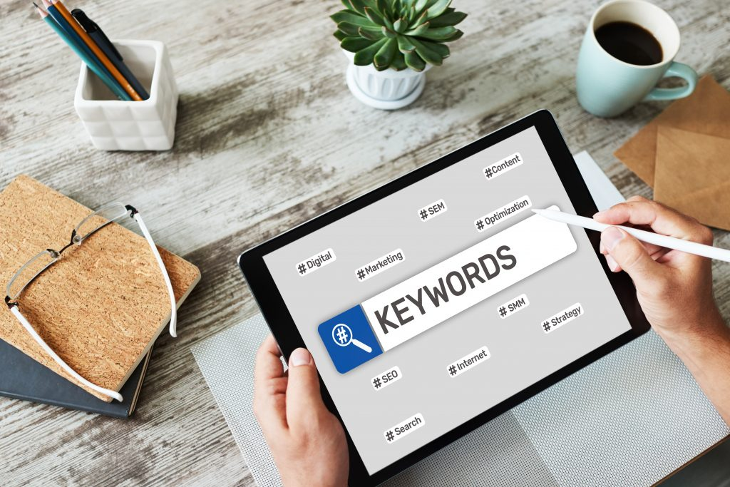 Person researching keywords on tablet