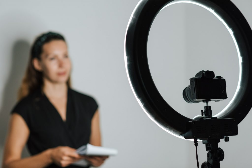 Woman in front of ring light