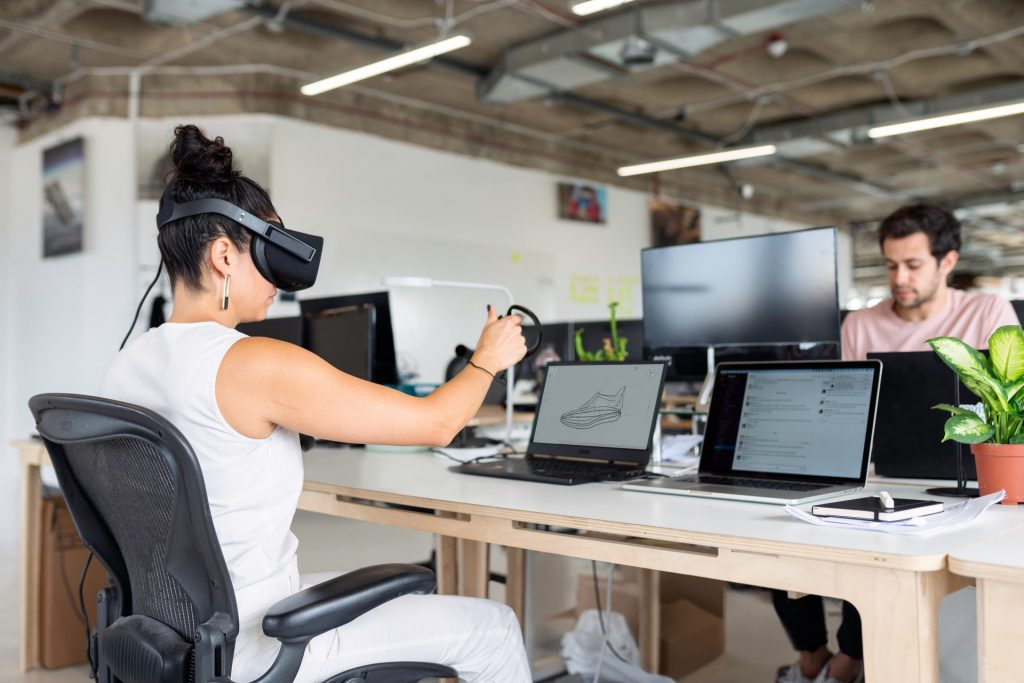 Woman with VR headset in office