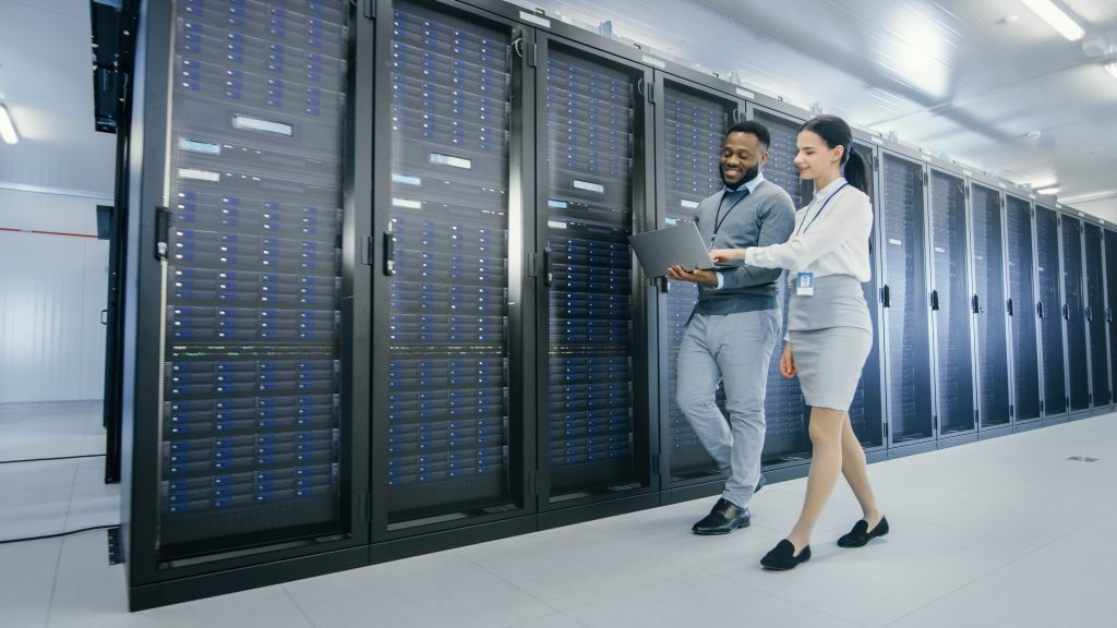Man and woman walking in server room