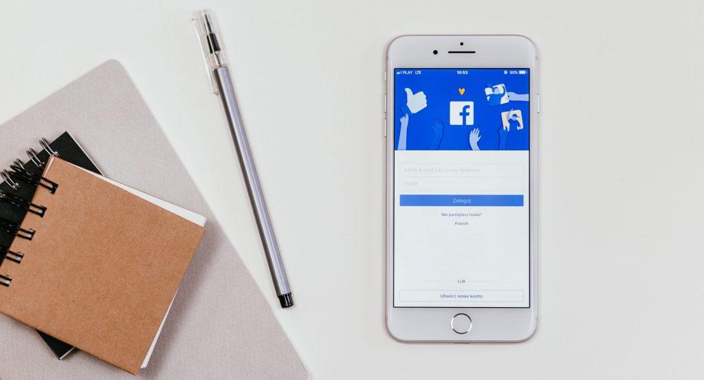 Facebook on white phone