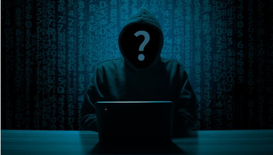 Hacker sitting in a room