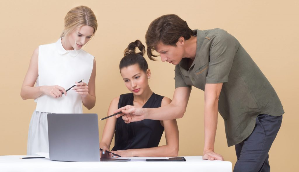 Colleagues looking at laptop