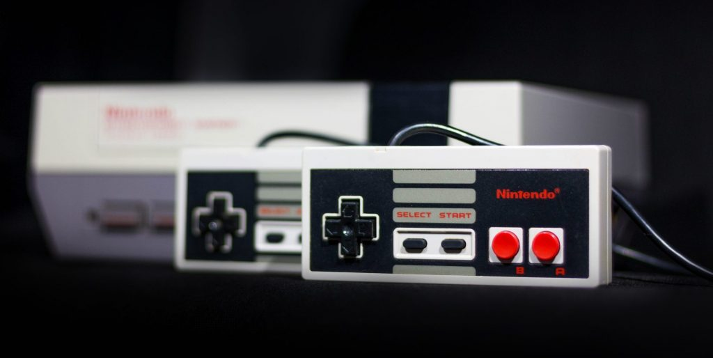 Gray nintendo nes console and controllers